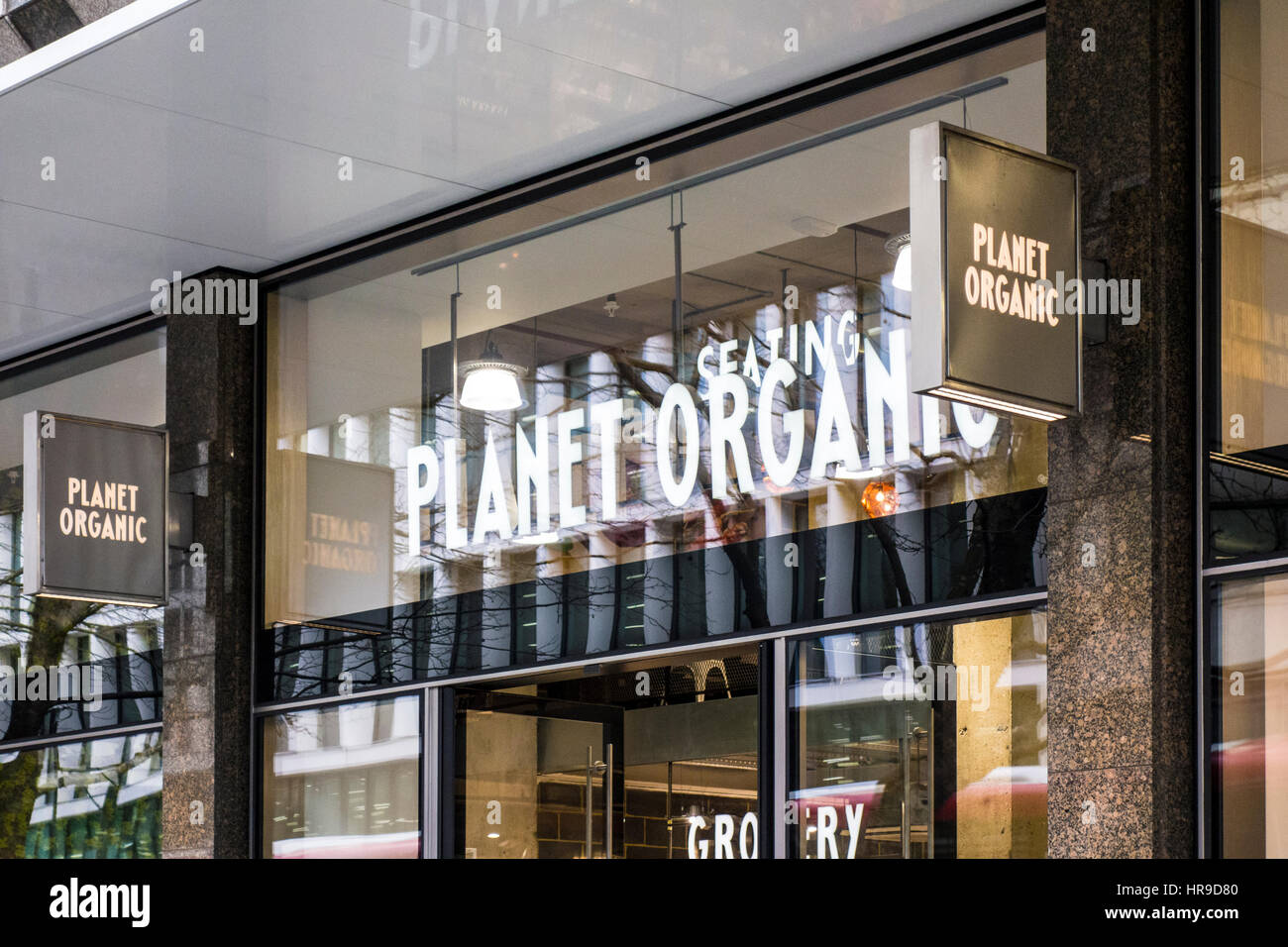 Planet Organic cafe restaurant shop store on Tottenham Court Road, London, UK - Stock Image