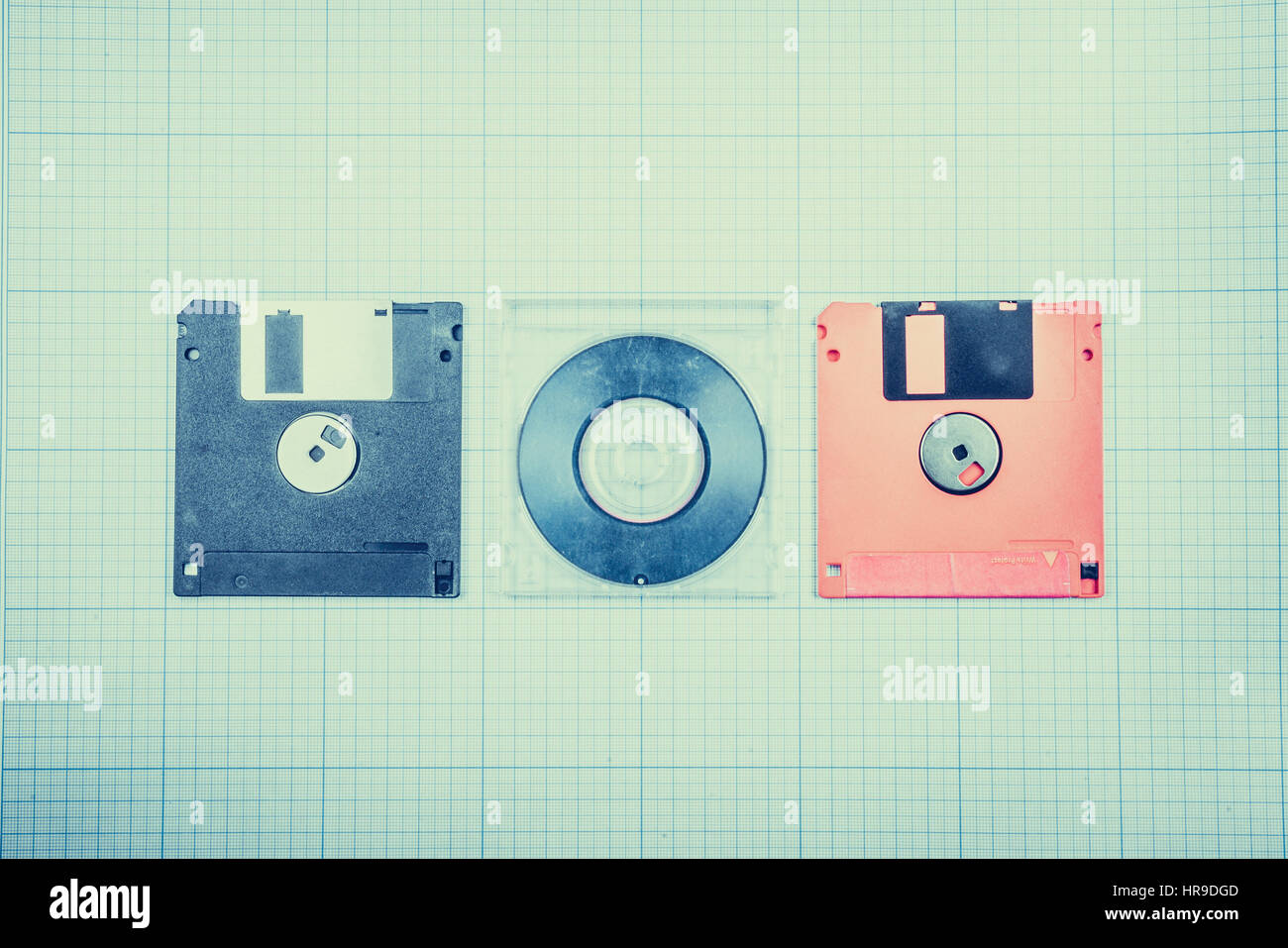Vintage background computer floppy disks and mini cd on the stock vintage background computer floppy disks and mini cd on the blueprint paper toned malvernweather Image collections