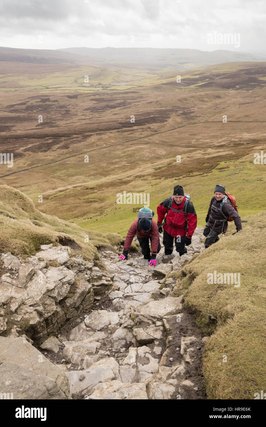 Hill-walkers climbing up Pen-y-Ghent in the Yorkshire Dales - Stock Image