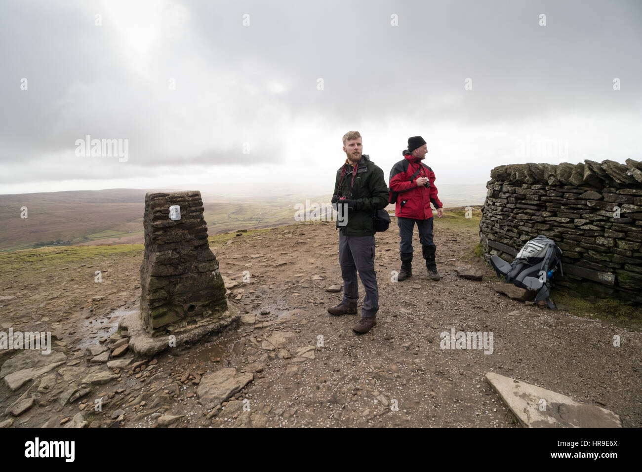Hill-walkers at the summit of Pen-y-Ghent in the Yorkshire Dales - Stock Image