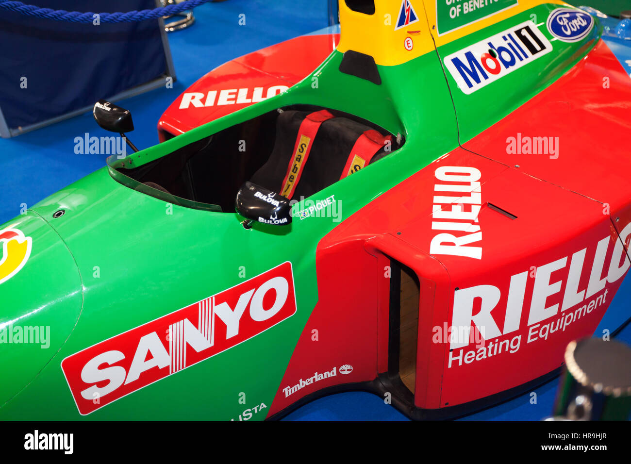 Close-up of the cockpit of Nelson Piquet's 1990, Benetton B190 Formula One Race Car from at the London Classic - Stock Image