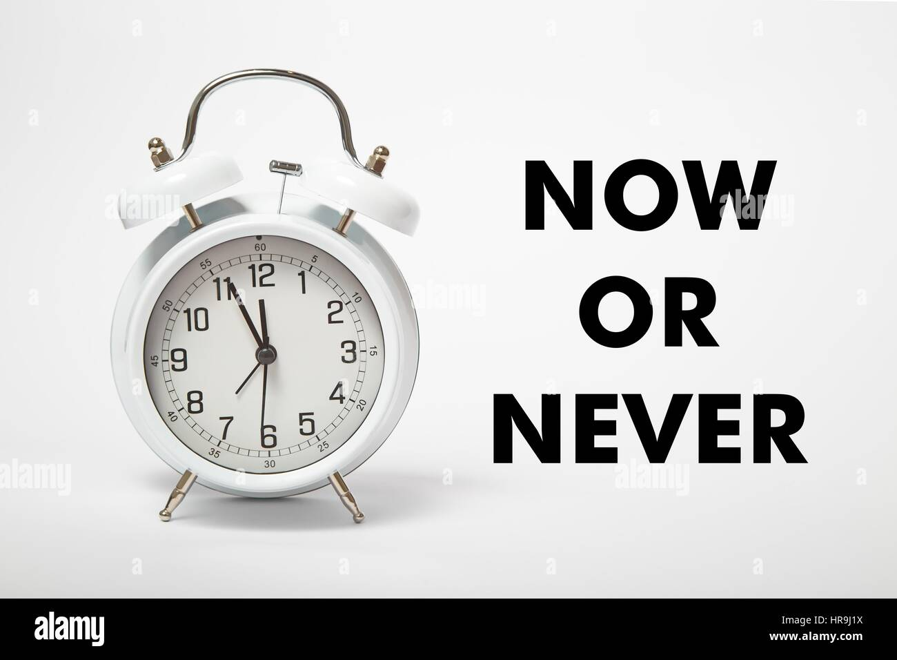 White old clock with text NOW OR NEVER - Stock Image