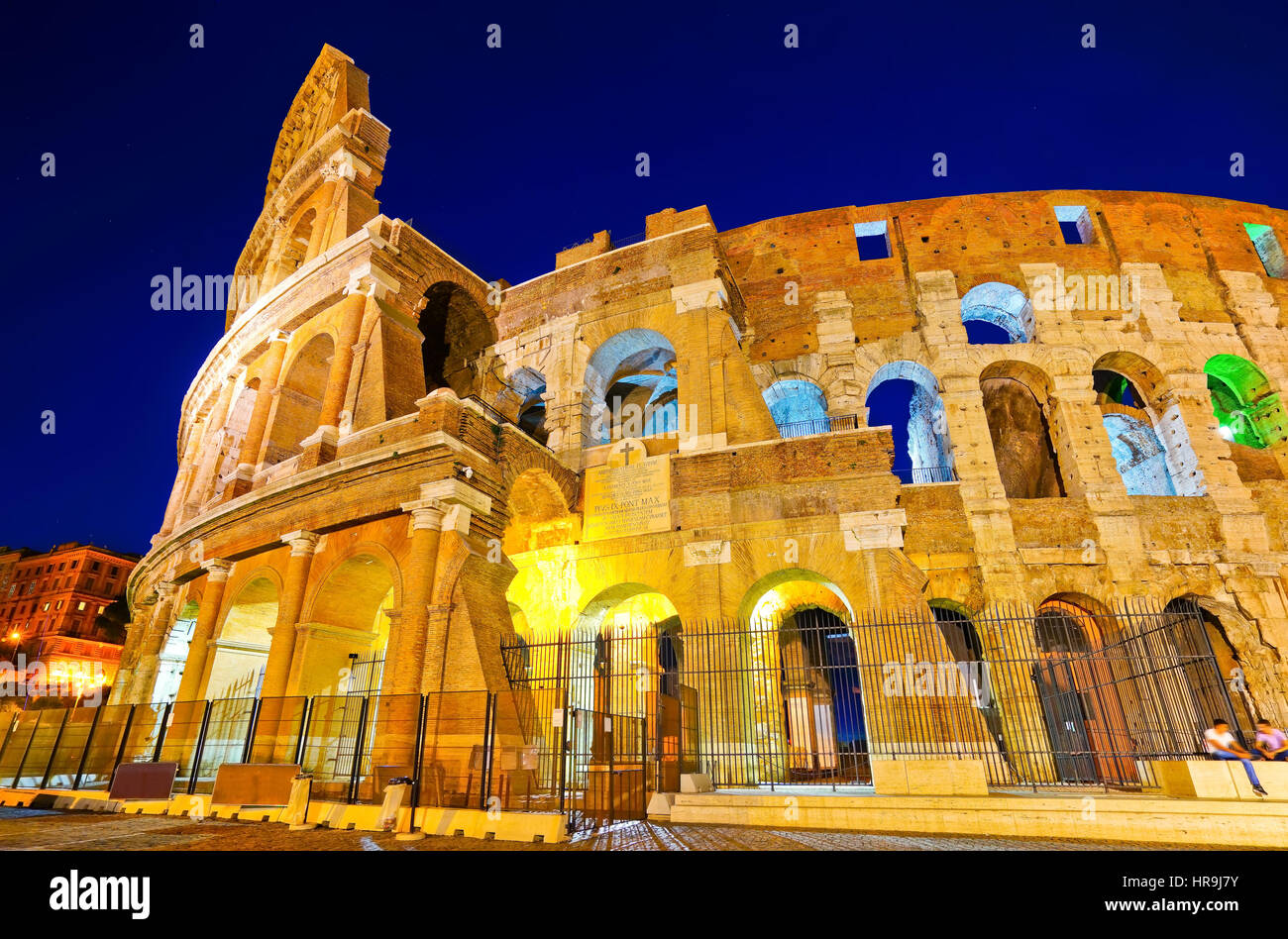 View of Colosseum at night in Rome, Italy - Stock Image