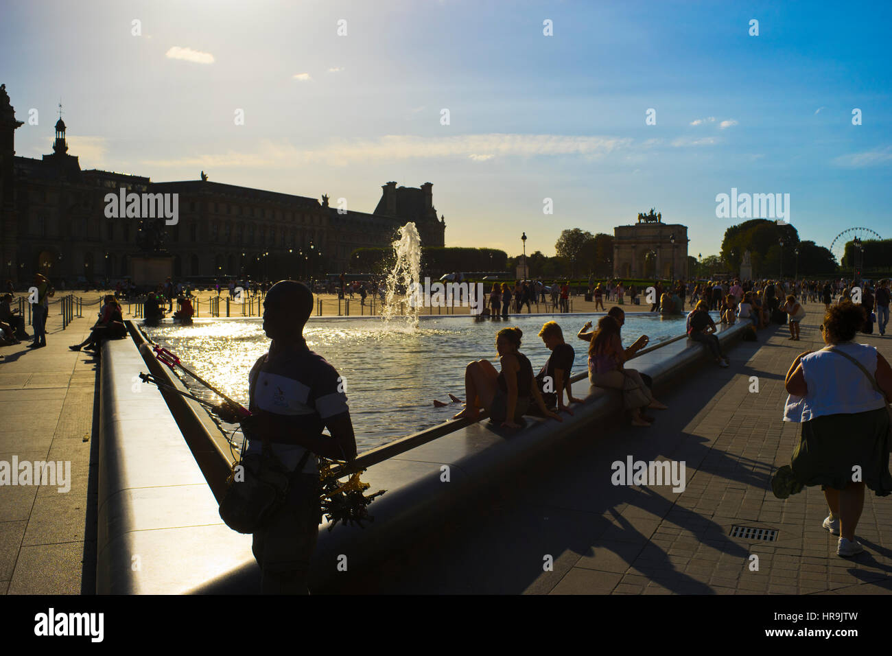Louvre Place with tourists on a sunny afternoon - Stock Image