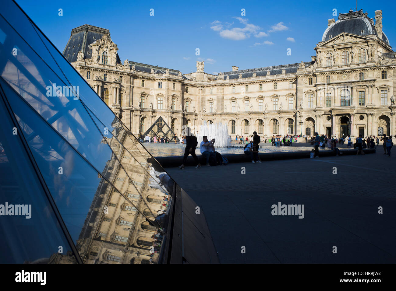 Louvre Pyramid mirroring the architecture - Stock Image