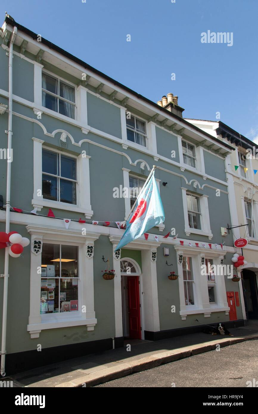 A flag flies outside the newly refurbished Ashburton Post Office, Devon - Stock Image