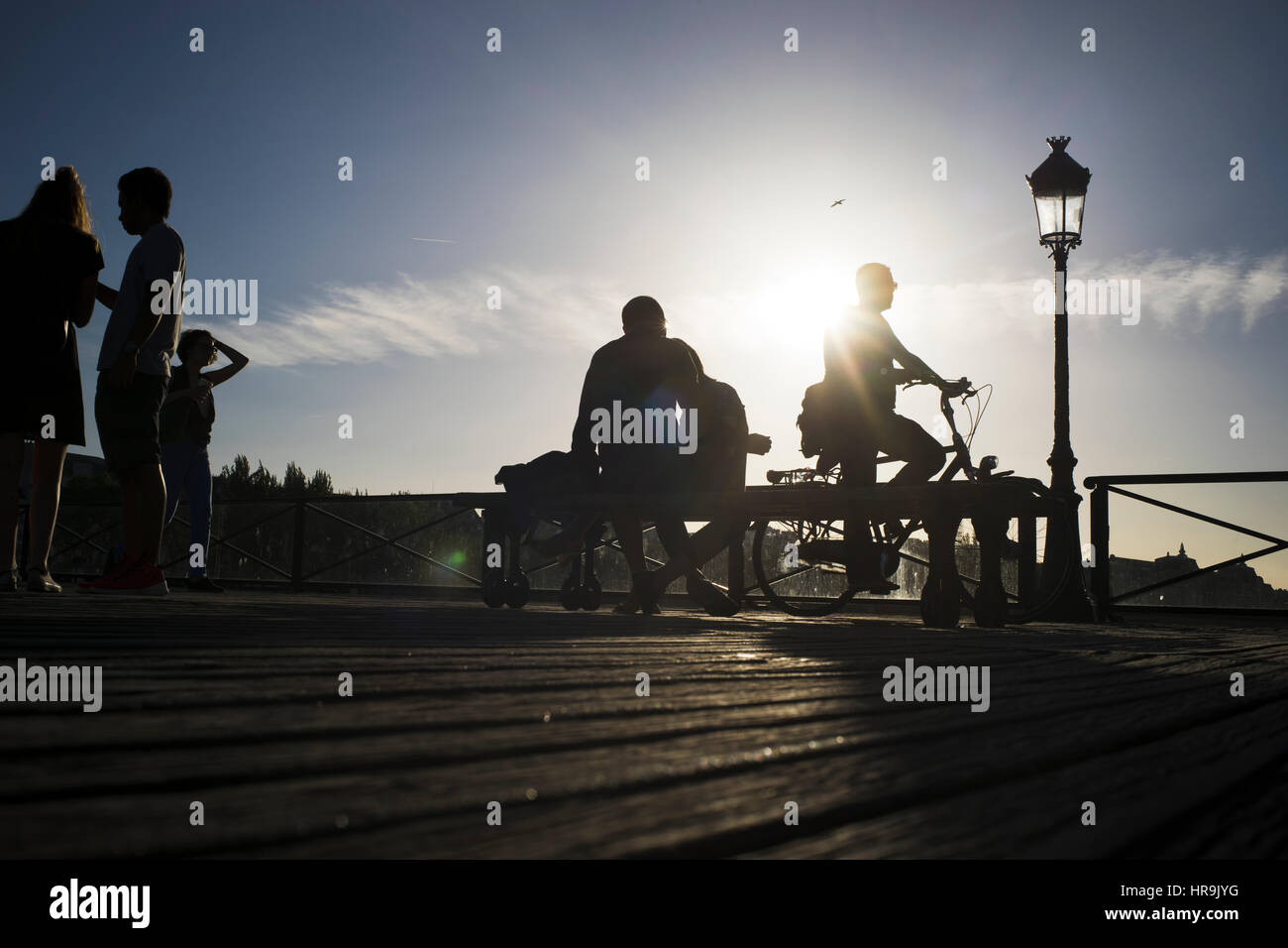 Silhouettes of people on a sunny afternoon at pont des arts in paris, france - Stock Image