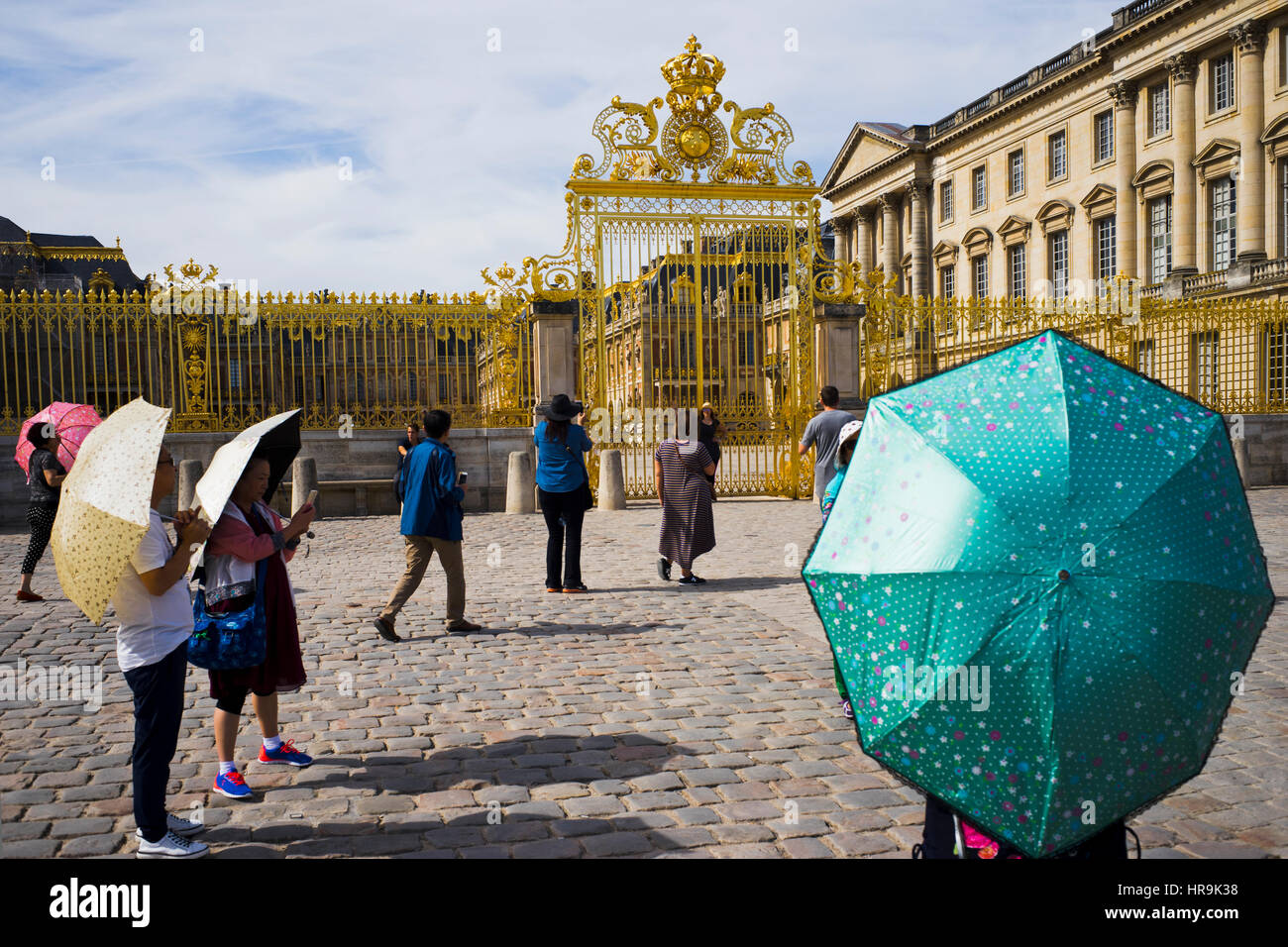 a group of asian tourists in front of versailles palace Stock Photo