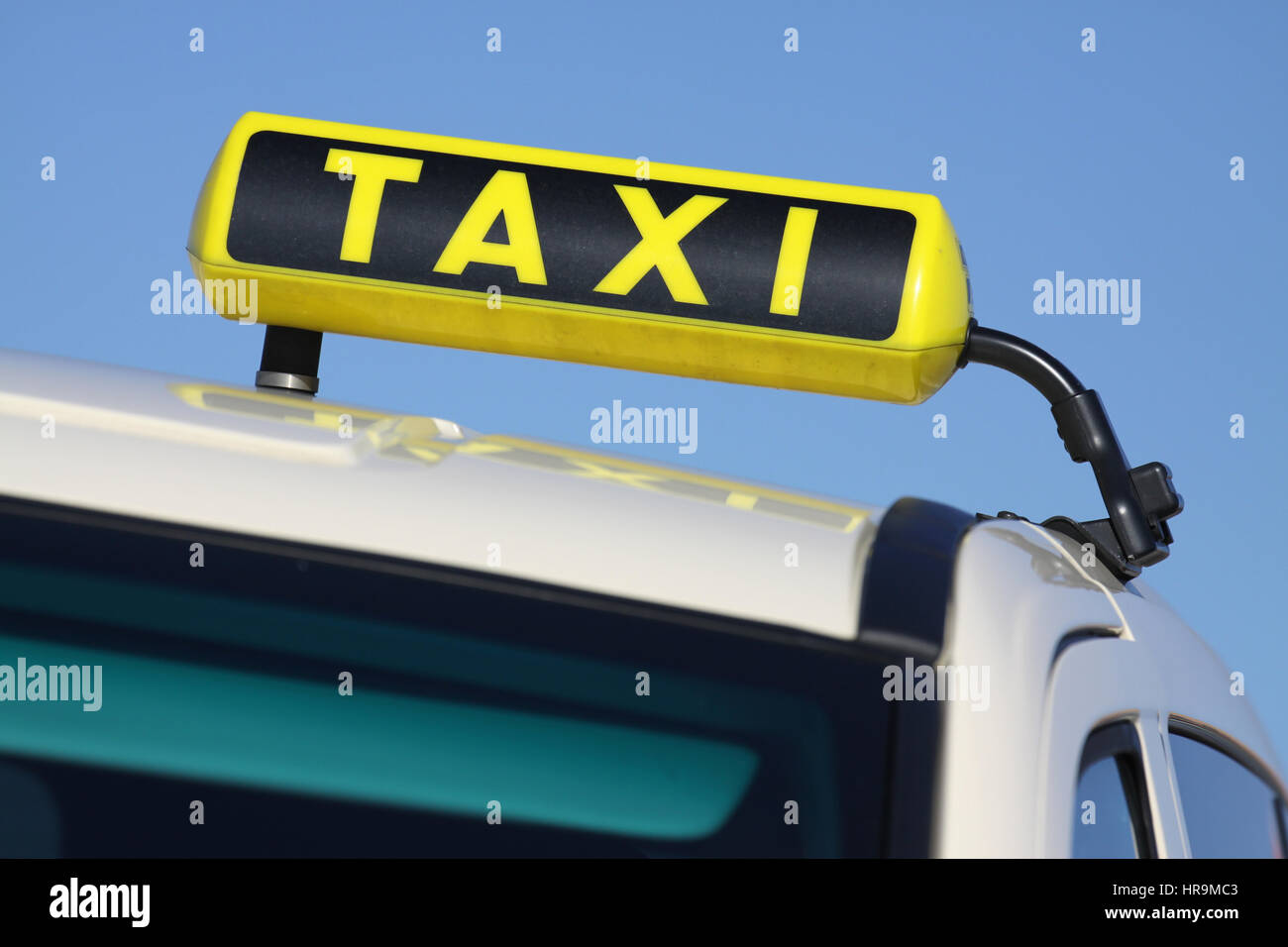German taxi sign against blue sky - Stock Image