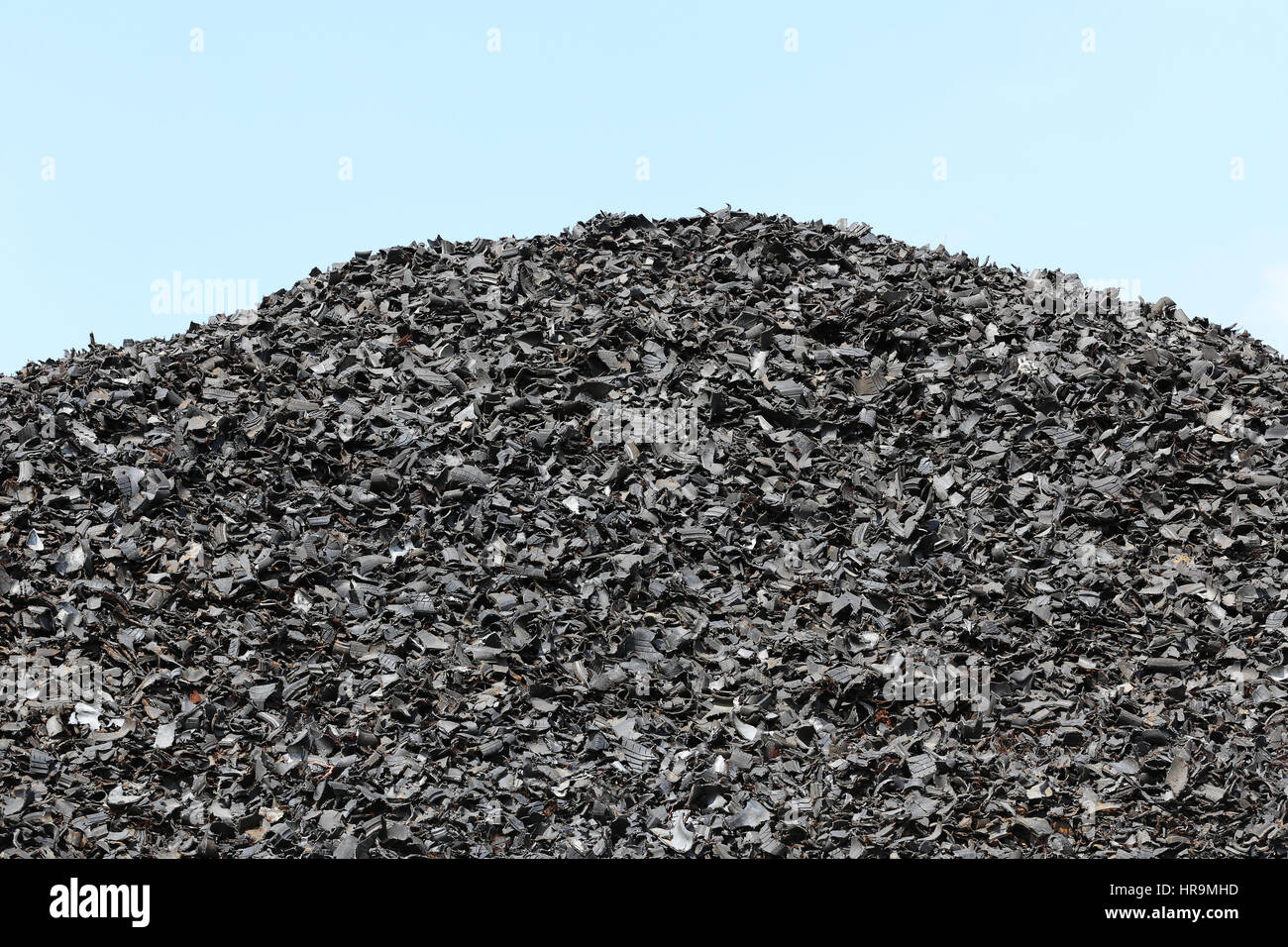shredded tires at recycling yard - Stock Image