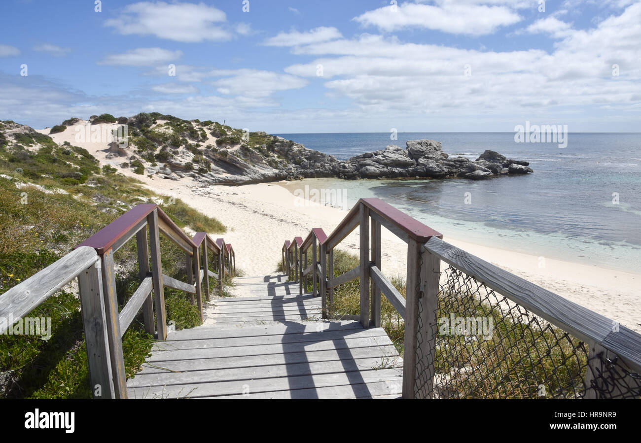 Boardwalk beach entrance with Indian Ocean view, dunes and limestone outcropping at Rottnest Island in Western Australia. - Stock Image