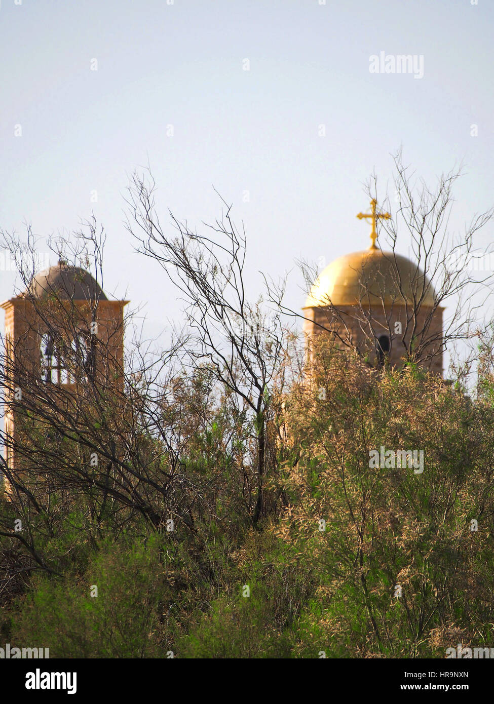 The gold dome and cross of an orthodox church at the holy site of Bethany Beyond the Jordan. Stock Photo