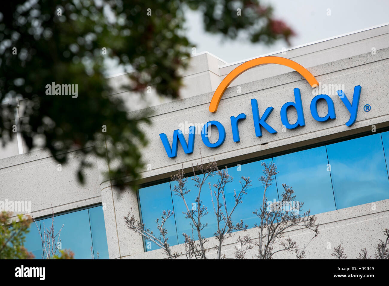 A logo sign outside of the headquarters of Workday, Inc , in