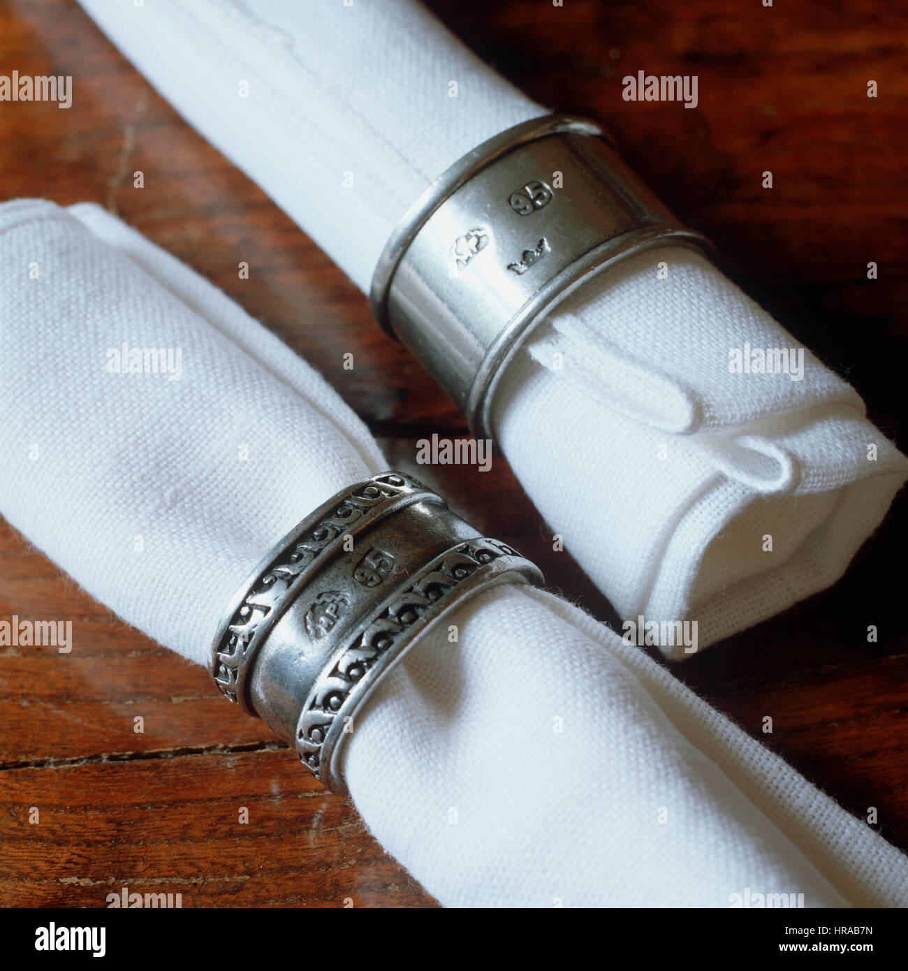 Napkins in silver napkin rings. - Stock Image
