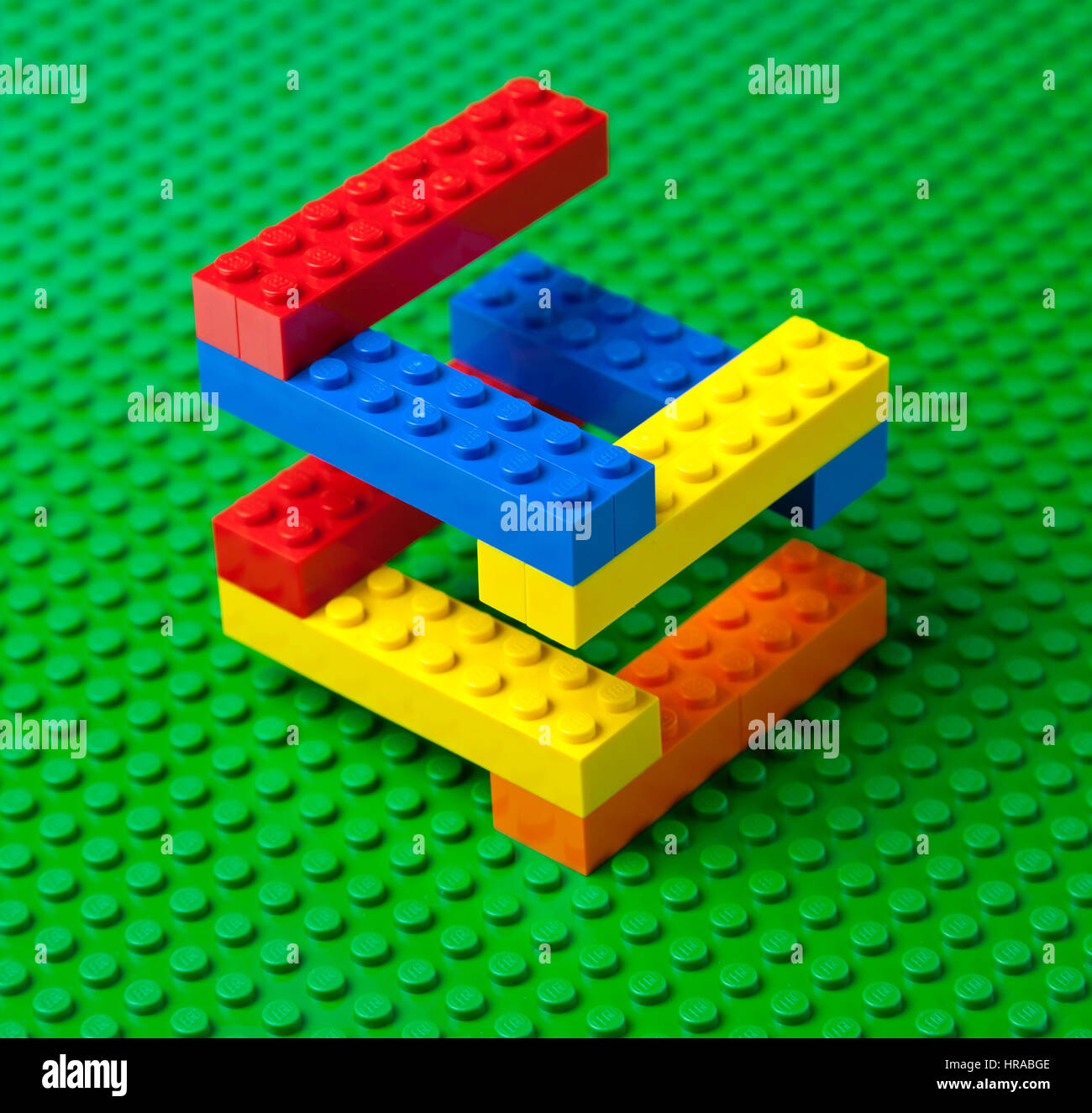 Colourful Lego brick construction or staircase on a green Lego base plate. - Stock Image