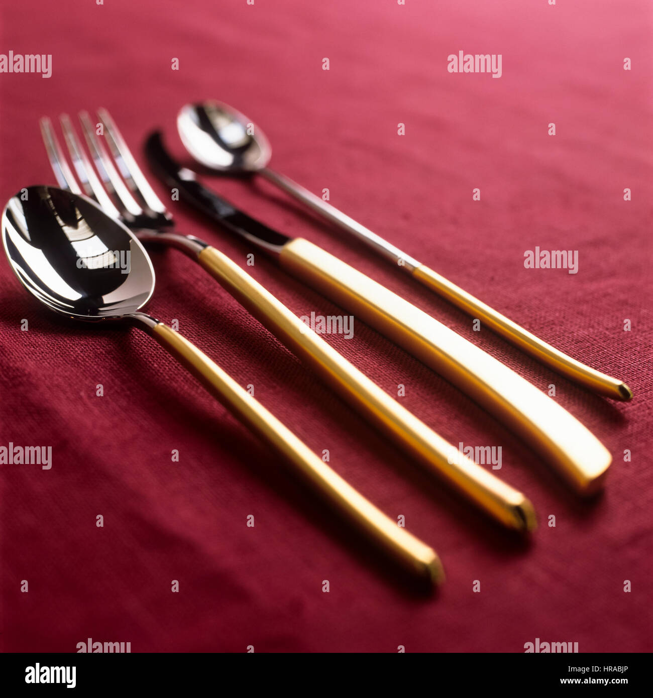 Gold and silver cutlery. - Stock Image