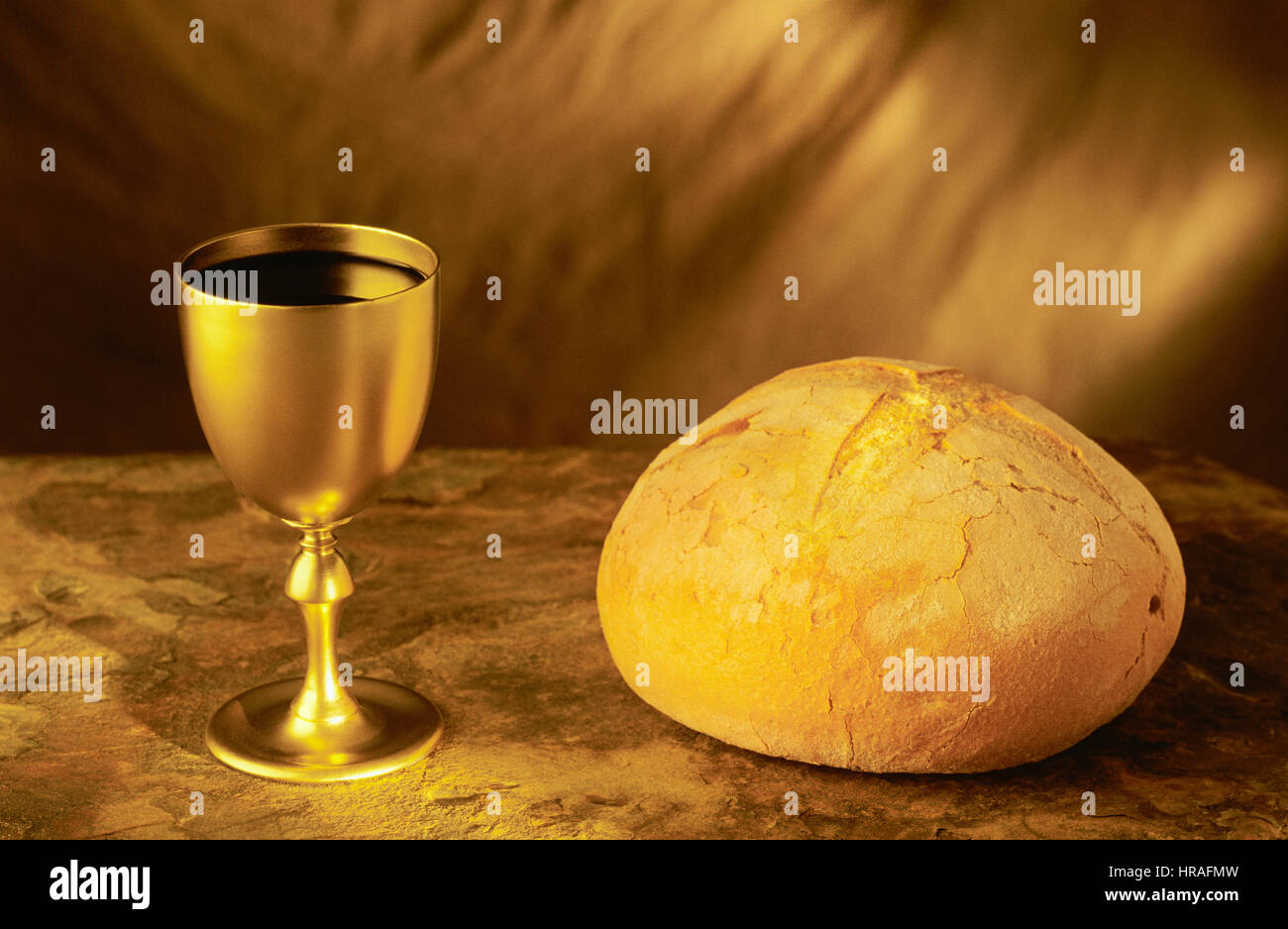 Wine Goblet And Broken Bread Symbols Of Communion Stock Photo