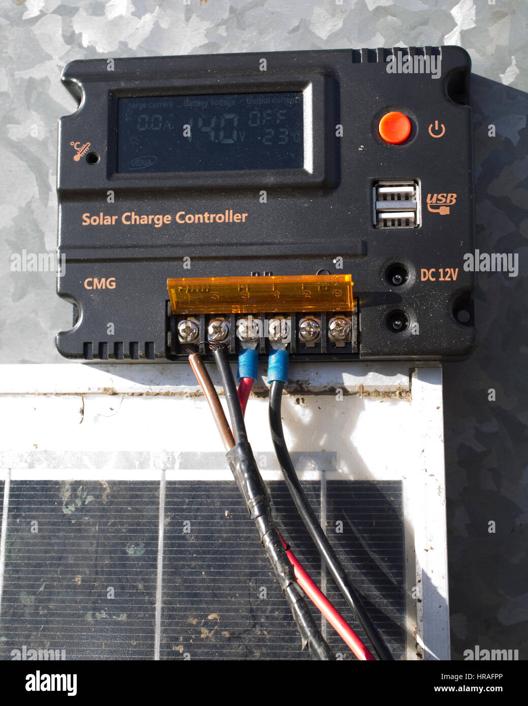 Solar charge controller CMG preventing overcharging of lead acid battery UK - Stock Image