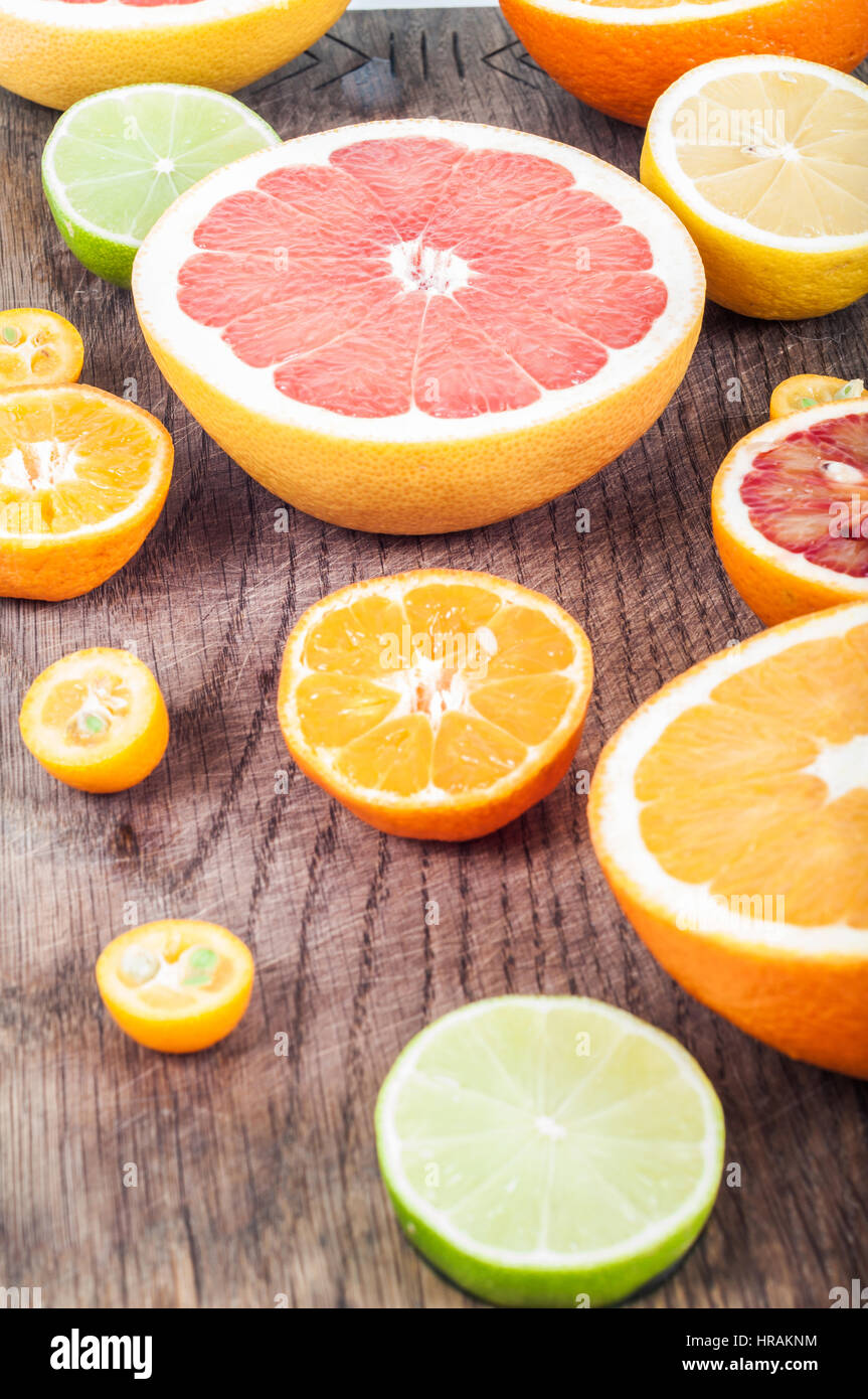 Colorful fresh citrus fruit on wooden background. Orange, tangerine, lime, blood orange, lemon, grapefruit. Fruit Stock Photo