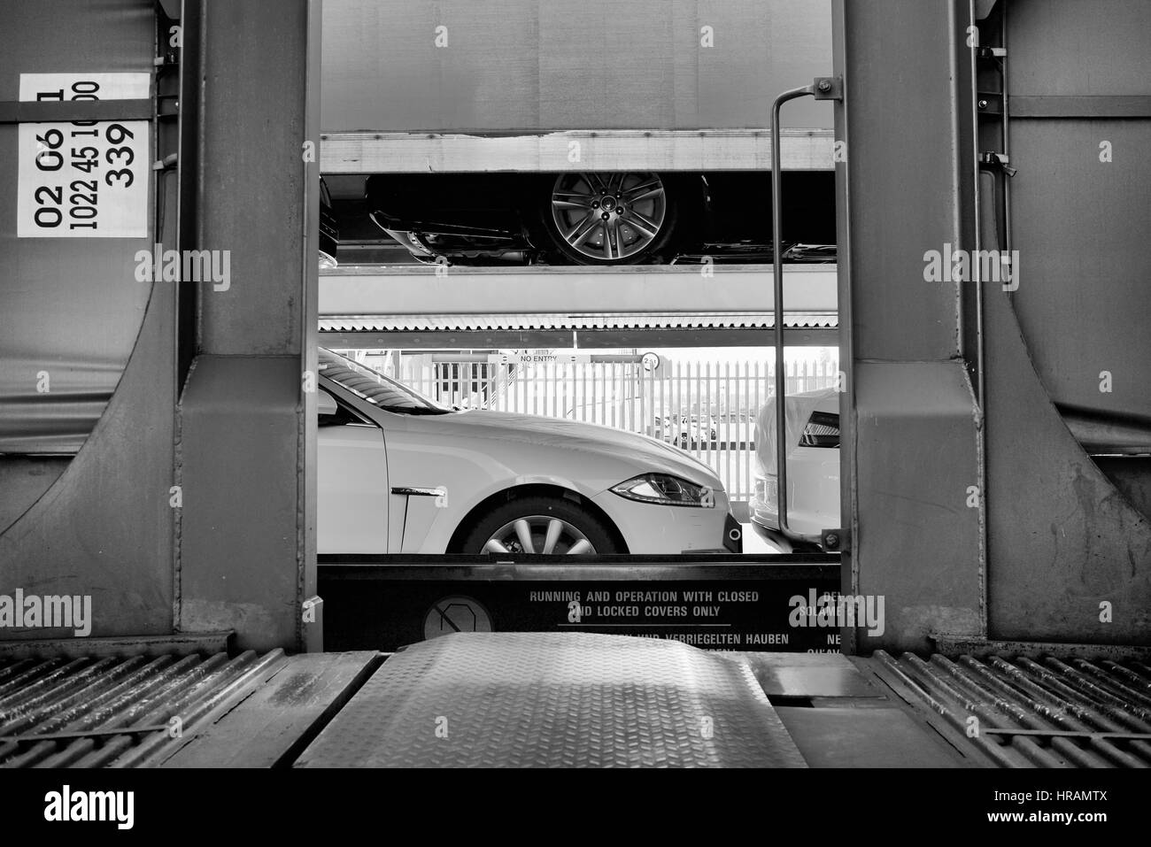 Unloading cars from a train in The Port of Southampton, England - Stock Image