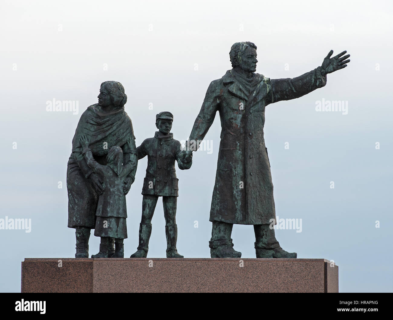 A bronze sculpture in the form of a young emigrant family as the 'Auswandererdenkmal' (lt.emigration monument) - Stock Image