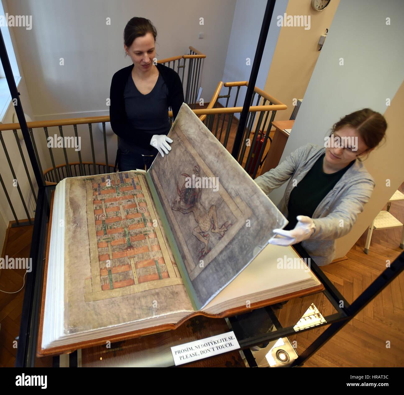 Librarians Ludmila Netusilova, left, and Martina Vodakova adjust