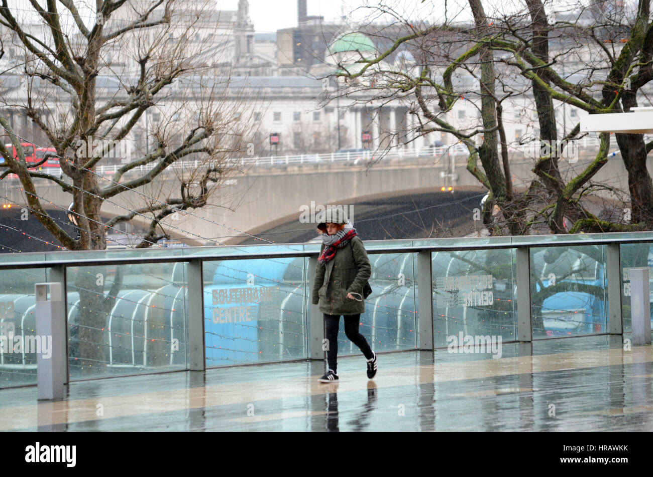 London, UK. 28th Feb, 2017. UK Weather. Rain on the South Bank of the Thames in front of the Royal Festival Hall - Stock Image