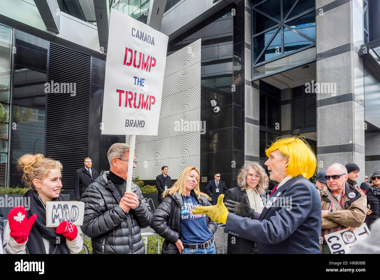Vancouver, Canada. 28th Feb, 2017. Anti-Trump protestors. Trump Hotel Tower official opening, Vancouver, British - Stock Image