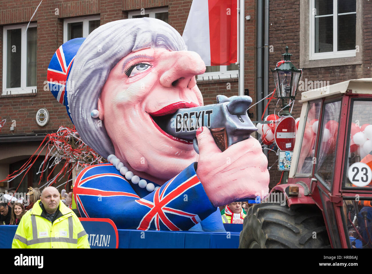 Düsseldorf, Germany. 27 February 2017. Theresa May shooting herself in the mouth over Brexit. Carnival parade - Stock Image