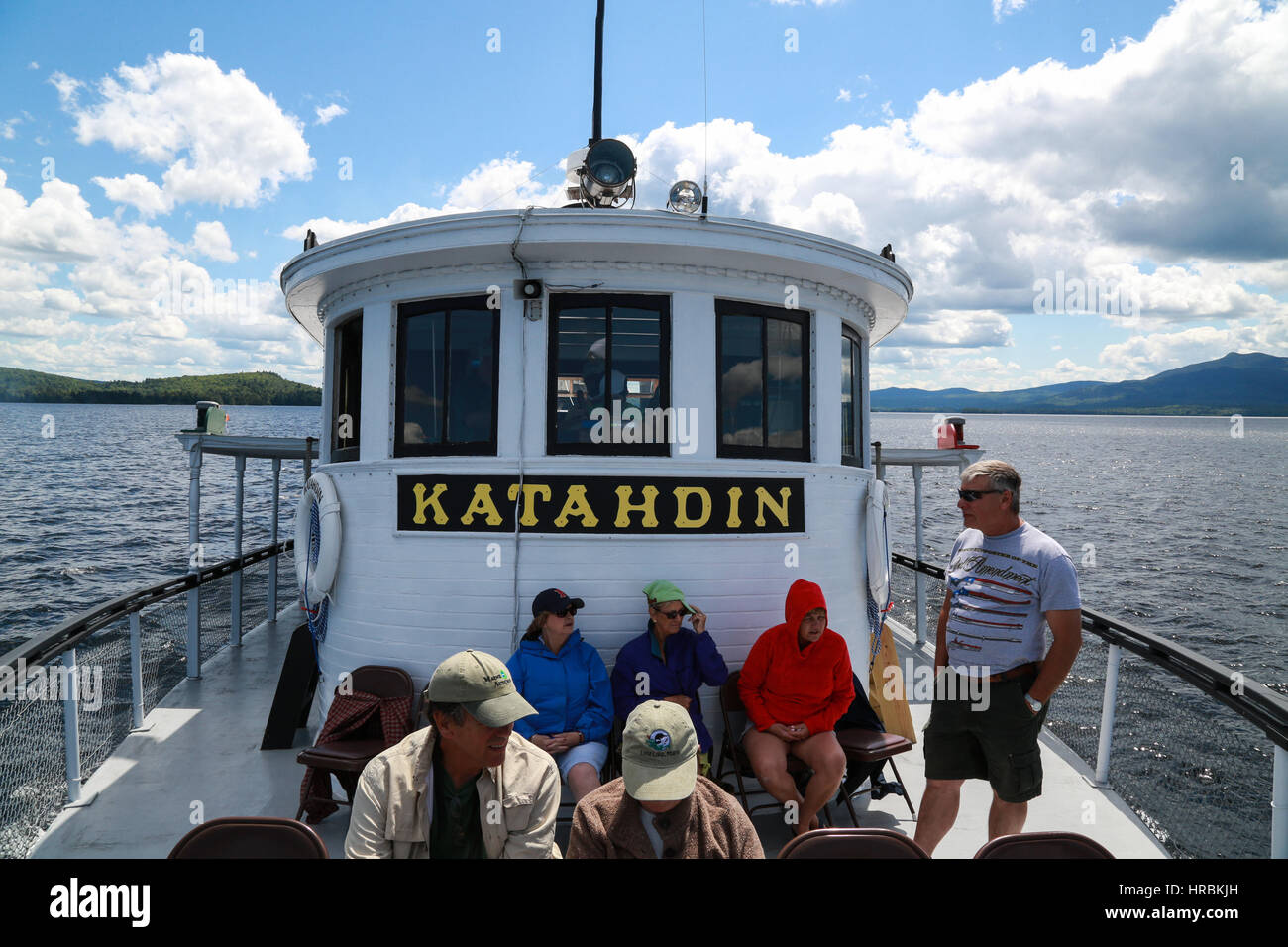 Day trip passengers taking a cruise on Moosehead Lake aboard the Century-old Motor Vessel Katahdin Stock Photo