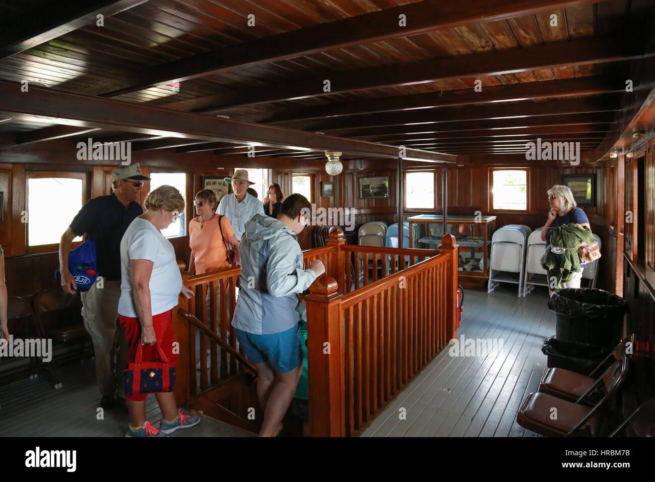 Day trip passengers debarking from the Century-old Motor Vessel Katahdin Stock Photo