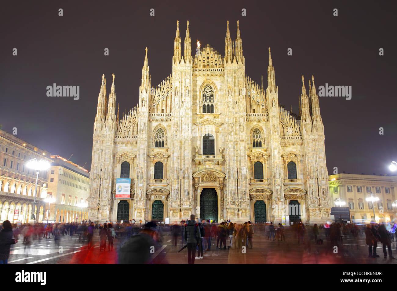 Milan Cathedral (Duomo di Milano) at night, Italy (People in motion blur) - Stock Image