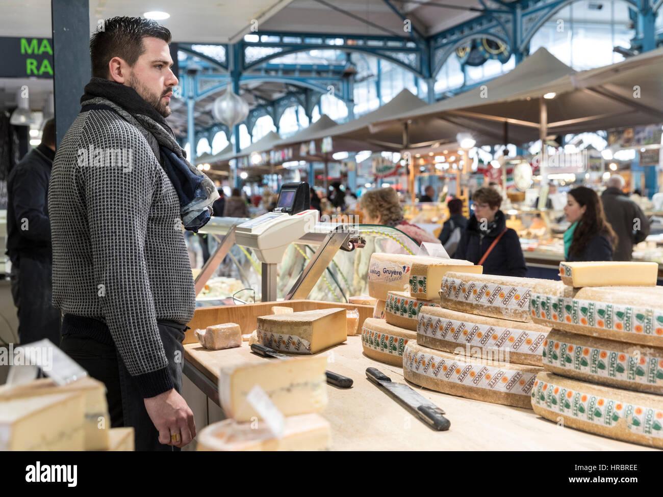 Cheese vendor, Covered Market, Dijon, Burgundy, France - Stock Image