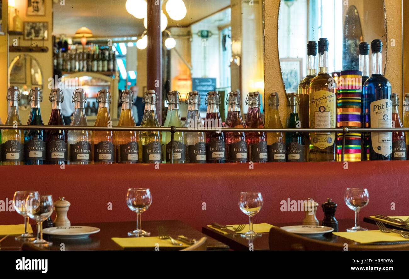 Pastis bottles lining a mirrored shelf, Chez Janou bistro, Rue Roger Verlomme in the Marais, Paris, France - Stock Image