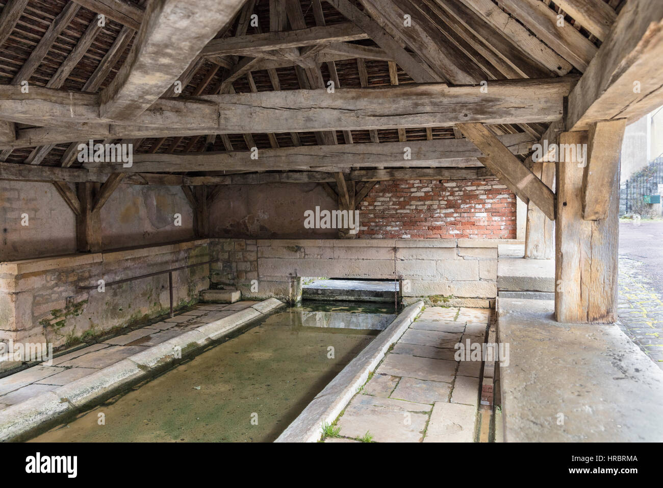 Wood beamed covered lavoir (communal washing pavilion), Domecy, Burgundy, France - Stock Image