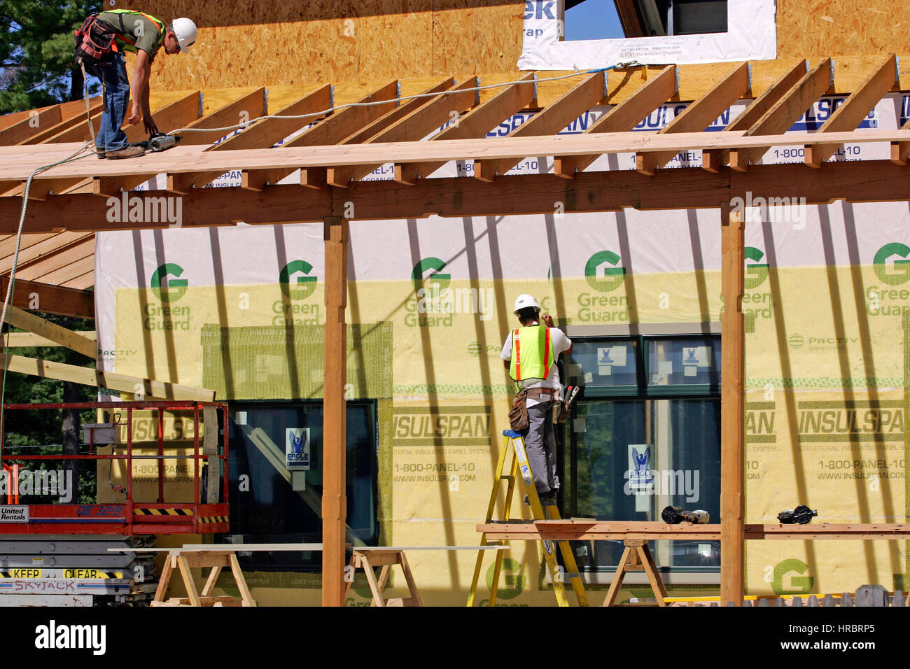 Maine Freeport building construction LL Bean carpenters workers building - Stock Image