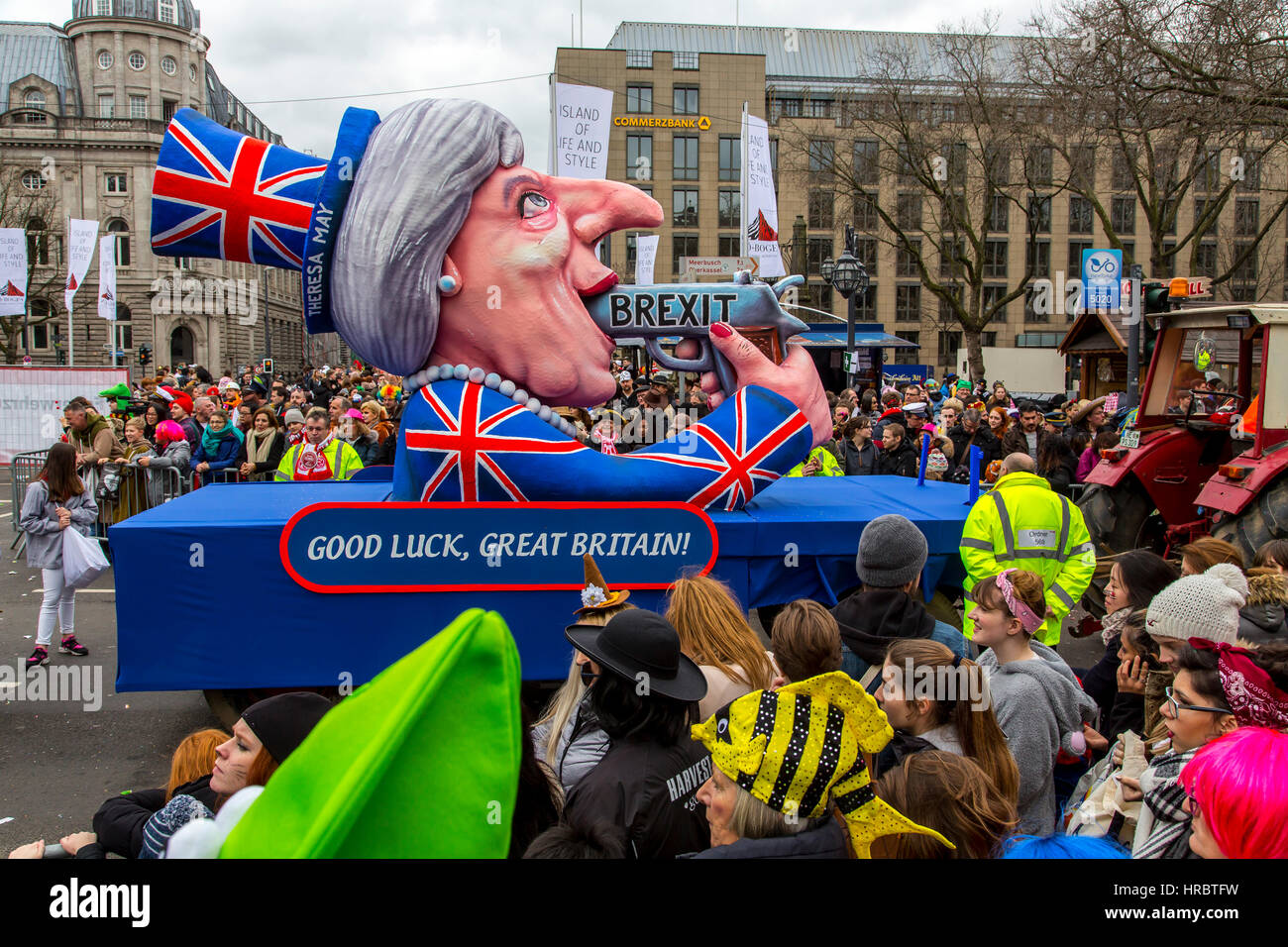 German Carnival parade in DŸsseldorf, Carnival floats designed as political caricatures, suicide by Brexit, British - Stock Image