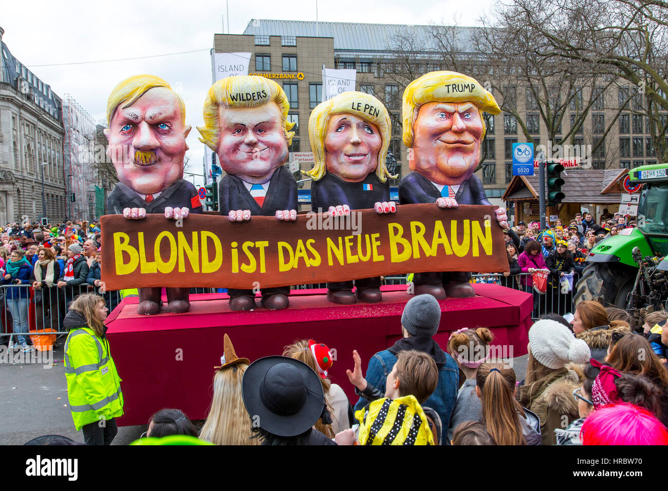 German Carnival parade in DŸsseldorf, Carnival floats designed as political caricatures, Blond is the new Brown, - Stock Image