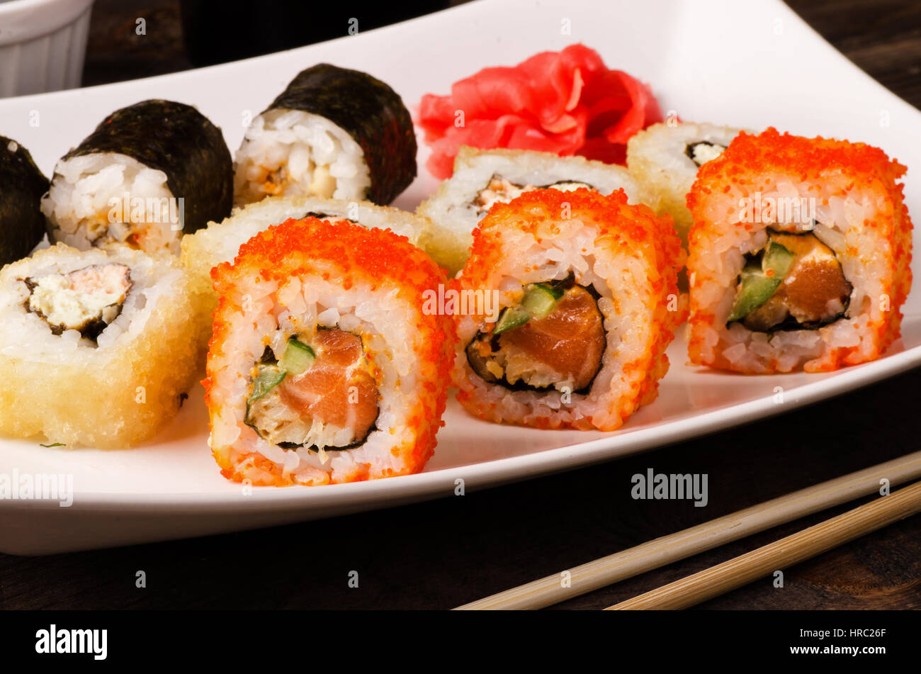 Different sushi roll set california, with salmon and shrimp tempura on a plate - Stock Image