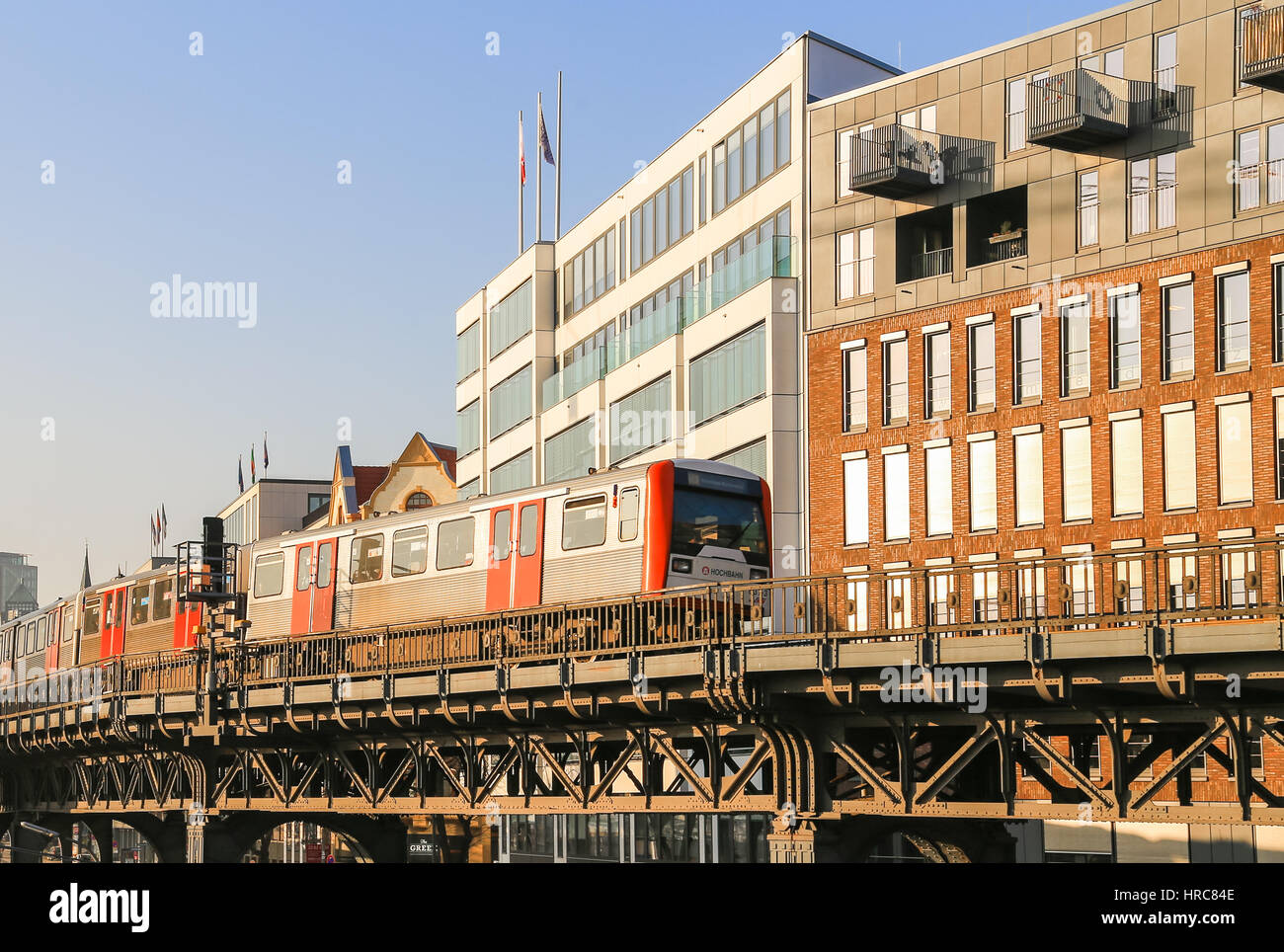 Hamburg, Germany - Februar 15, 2017: Subway train on a bridge in front of buildings near the station Baumwall. Stock Photo