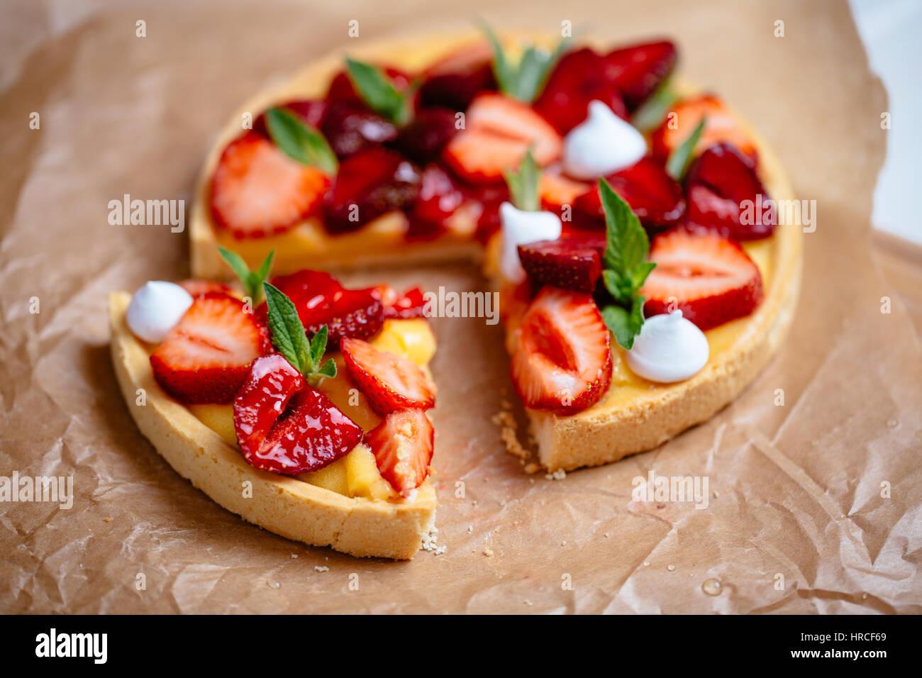 homemade preparing strawberry tart on white wooden desk - Stock Image