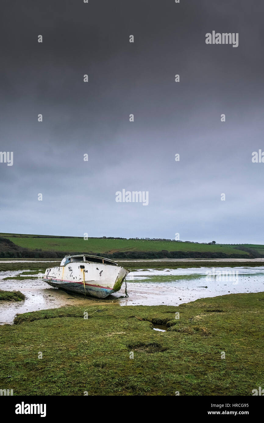 remains boat abandoned beached Gannel Estuary gloomy overcast day Newquay Cornwall UK weather - Stock Image