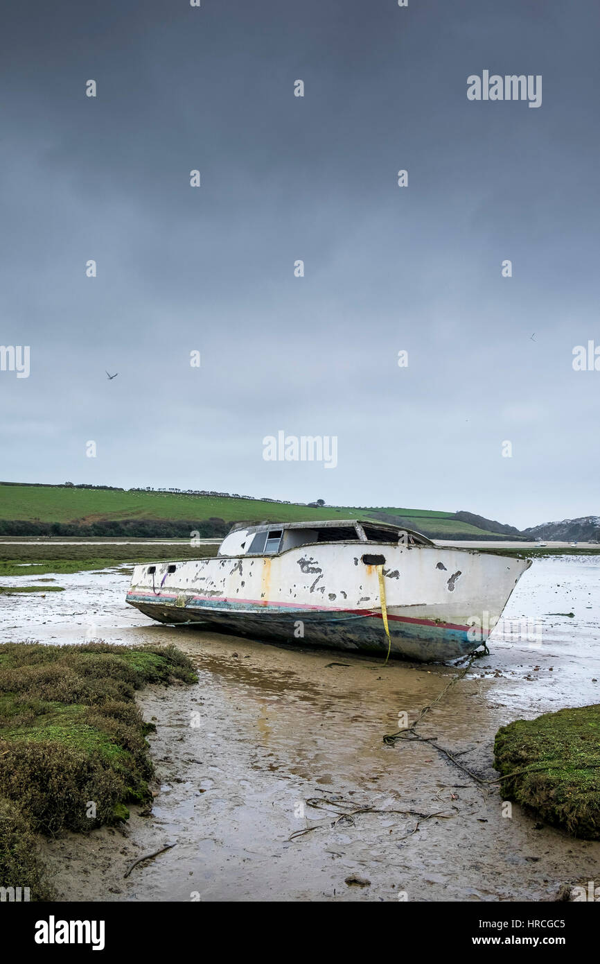 remains boat abandoned beached Gannel Estuary gloomy overcast day Newquay Cornwall UK weather Stock Photo