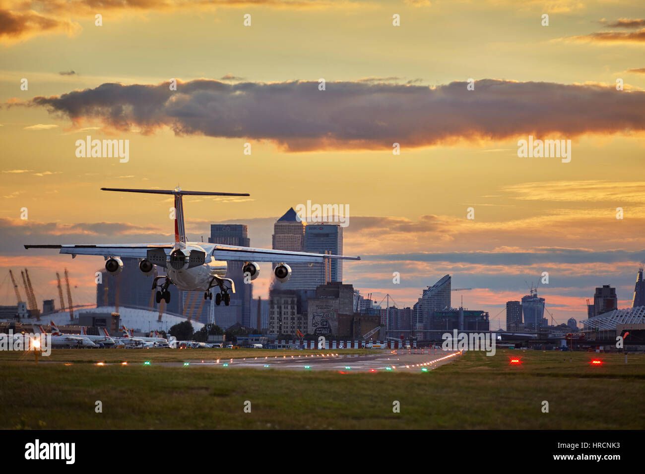 Landing Plane on London City Airport - Stock Image