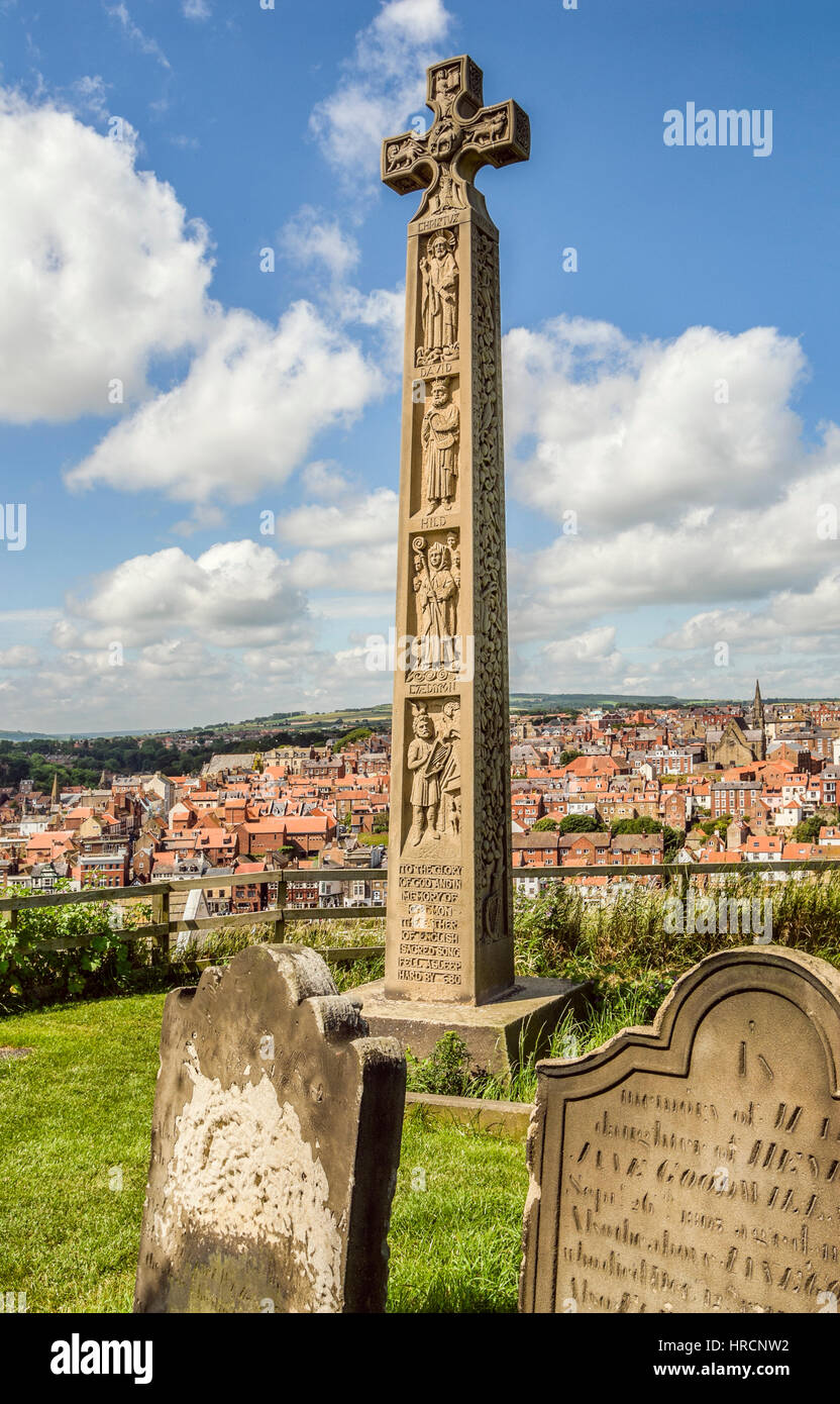 Celtic Cross at the Graveyard of Whitby Abbey. Whitby Abbey is a ruined Benedictine abbey overlooking the North - Stock Image