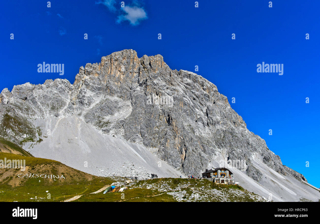 Mountain hut Carschinahütte beneath the south face of the Sulzfluh peak, St. Antönien, Prättigau, - Stock Image