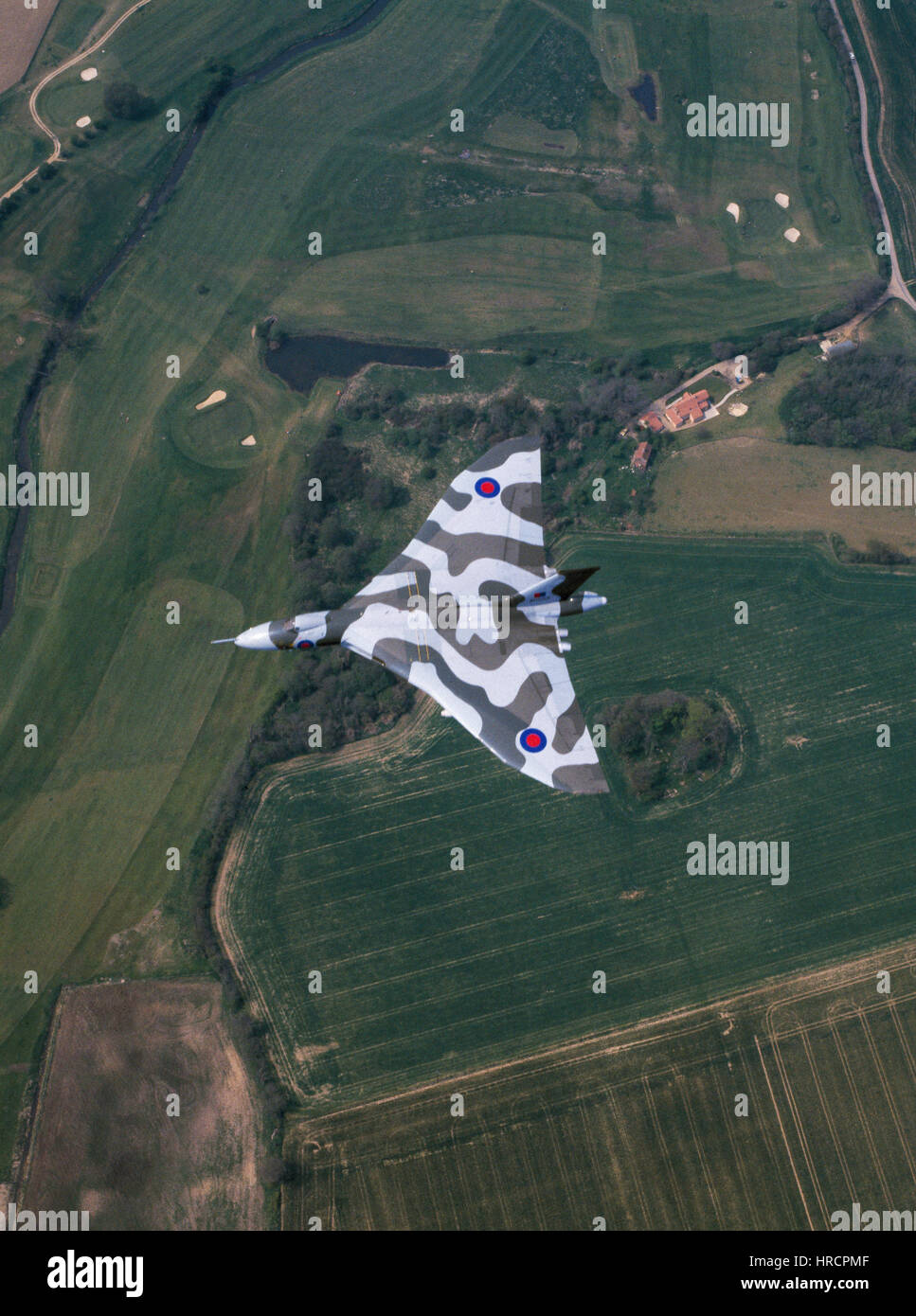 Avro Vulcan B2 bomber flying over the English countryside. - Stock Image