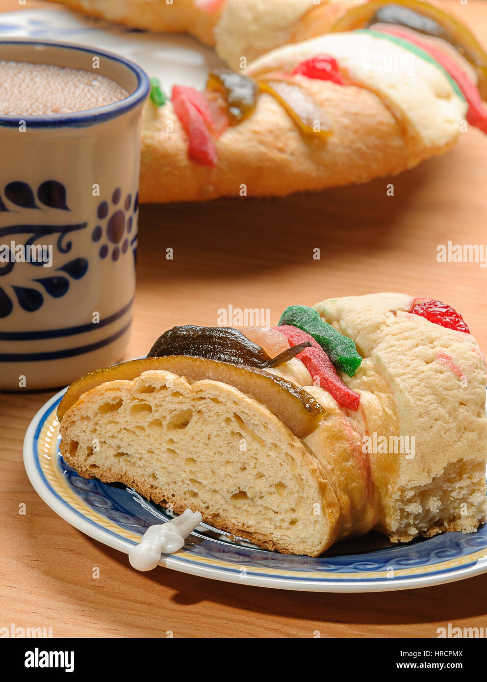Chocolate cup with Epiphany cake, Kings cake, Rosca de reyes or Roscon de reyes - Stock Image