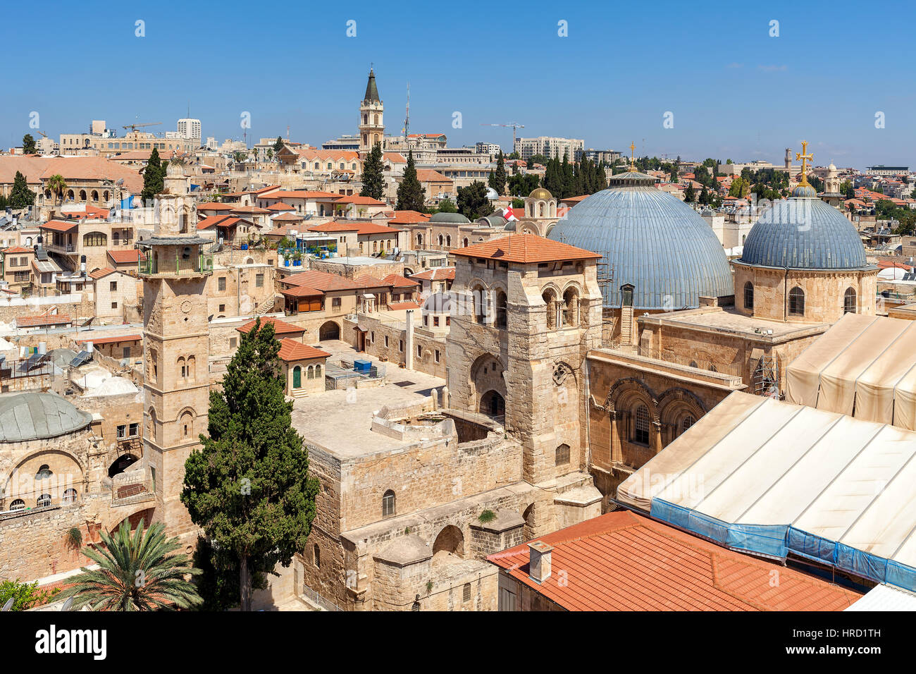 Church of the Holy Sepulchre domes, minarets and rooftops of the Old City of Jerusalem, Israel as seen from above. Stock Photo