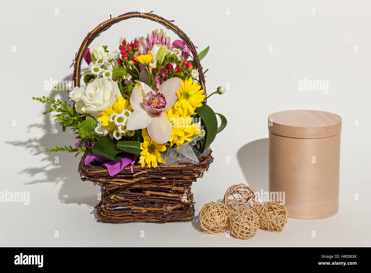 Different beautiful flowers in the basket round beige box and stock different beautiful flowers in the basket round beige box and handmade eggs close up on the white background izmirmasajfo